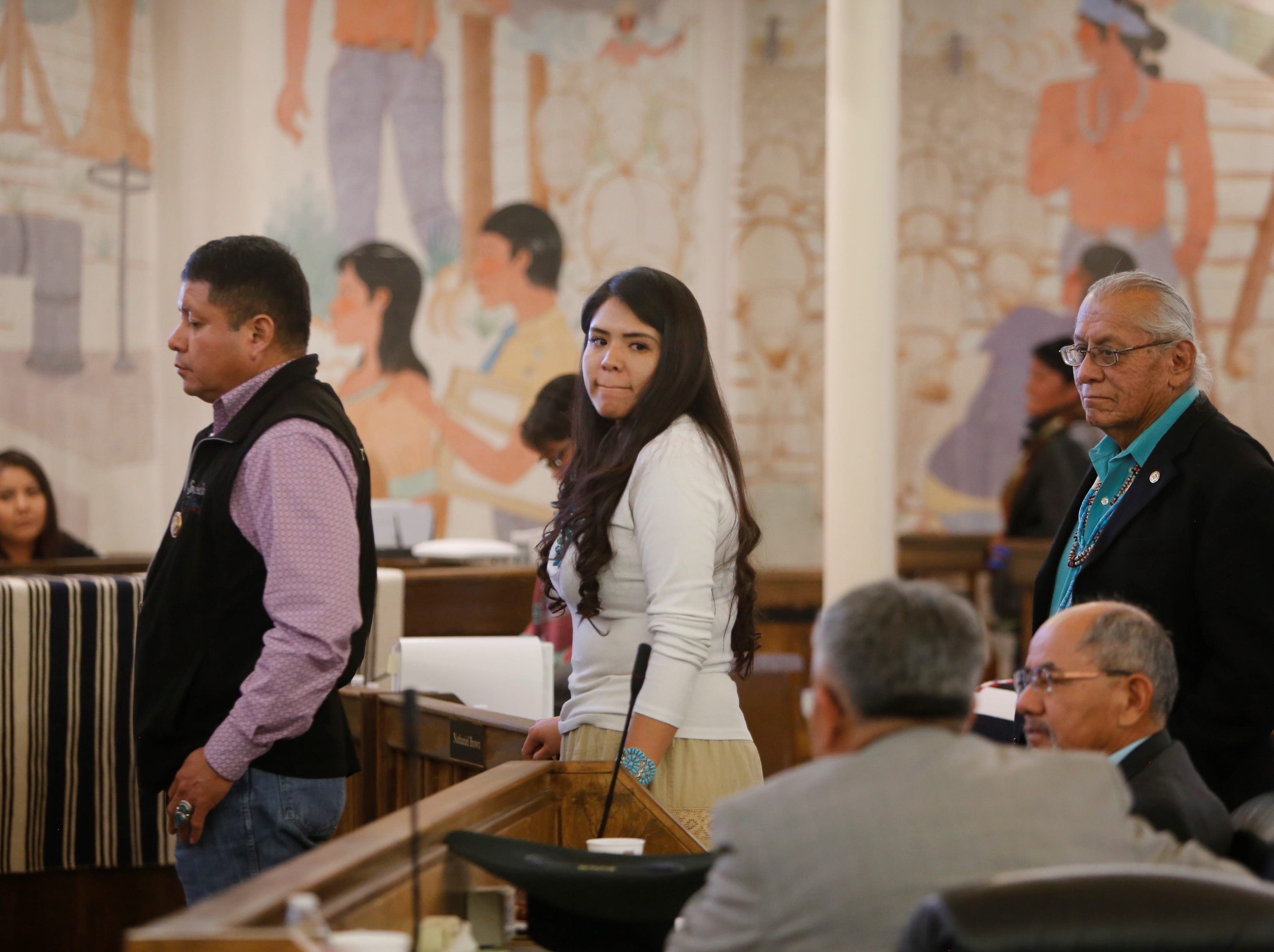 Delegate Charlaine Tso, center, waits to receive her ballot for the selection of a speaker for the Navajo Nation Council on Monday in Window Rock, Ariz.