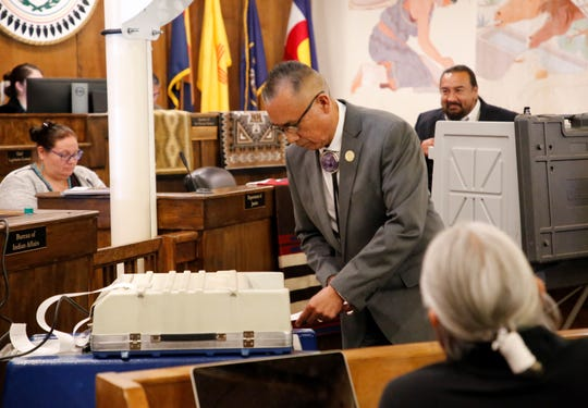 Delegate Rick Nez submits his ballot for the Navajo Nation Council speaker during the winter session on Monday in Window Rock, Ariz.