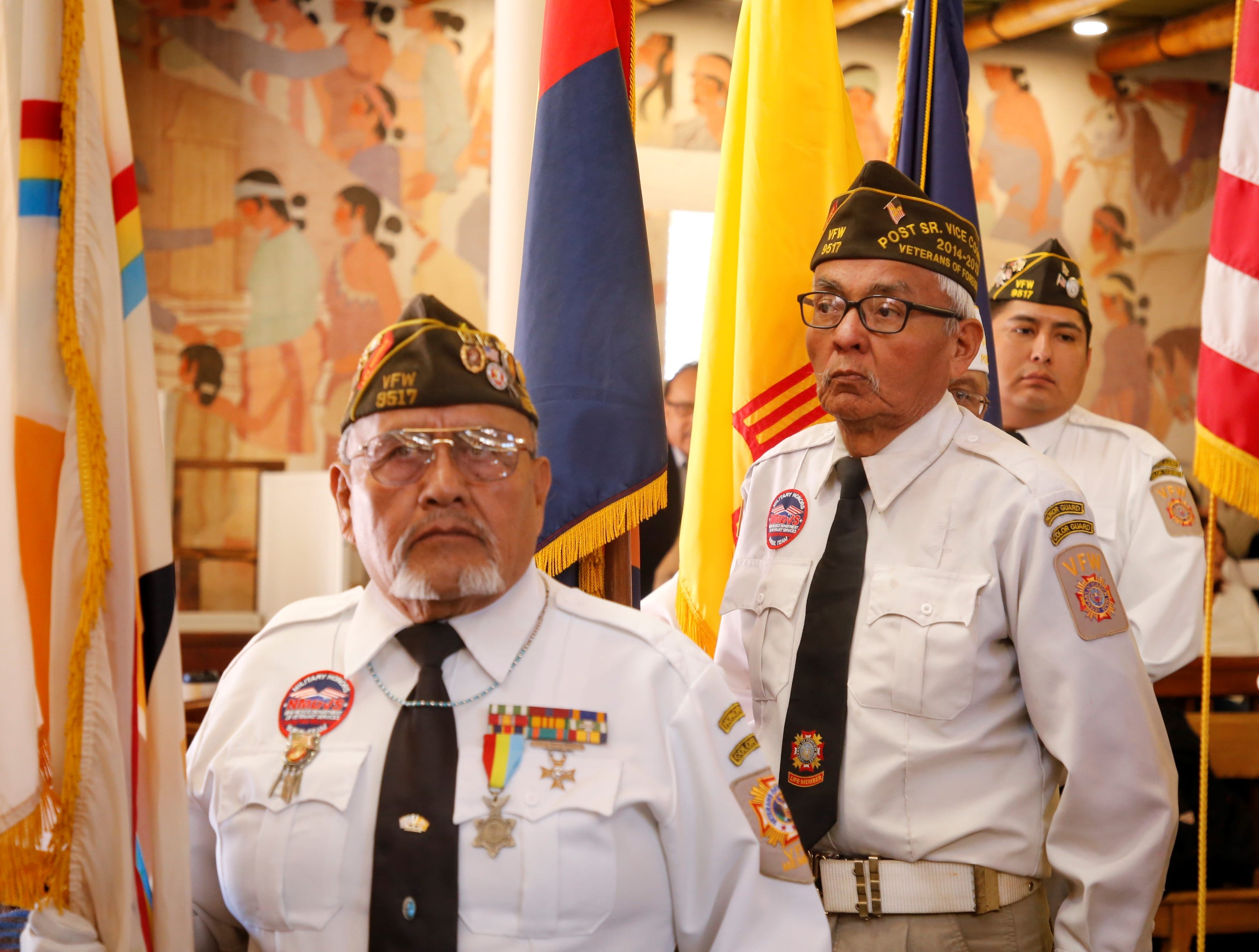 From left, Shiprock Veterans of Foreign Wars Post 9517 members Lester Light, Jonas John and Harlin Benally wait to post the colors for the Navajo Nation Council's winter session on Monday in Window Rock, Ariz.