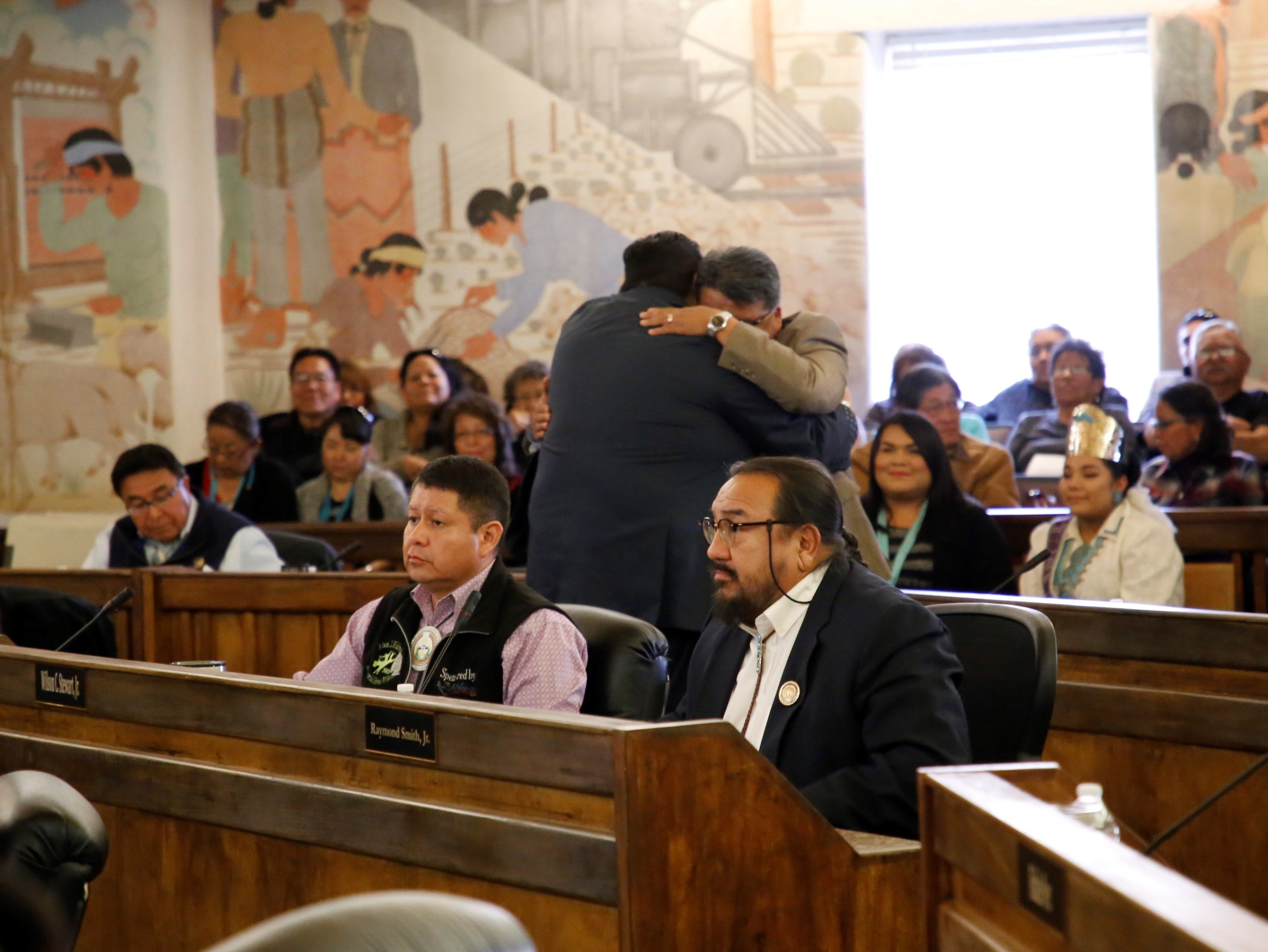 After Delegate Seth Damon received the most votes for the speaker seat, he hugged runner up Delegate Edmund Yazzie on Monday at the Navajo Nation Council chamber in Window Rock, Ariz.