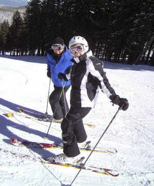 """""""Chica Christie"""" Larson and """"Chica Jane"""" Hoover pause for a moment on Chino, a fun slope to catch morning sun."""