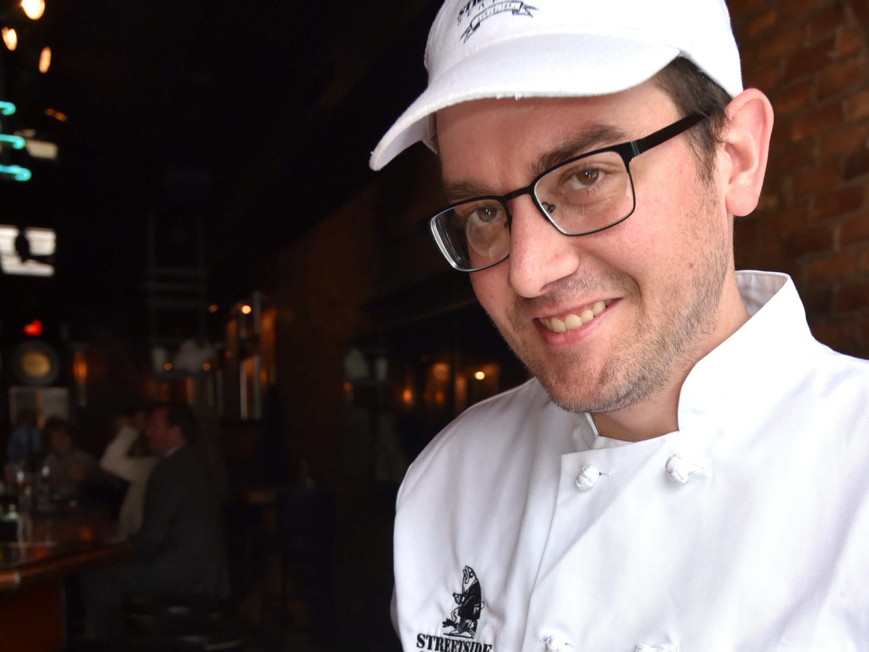 Streetside Seafood executive chef Jonathan Rickloff displays the Birmingham restaurant's seafood arrabiata woith shrimp, scallops and mussels.