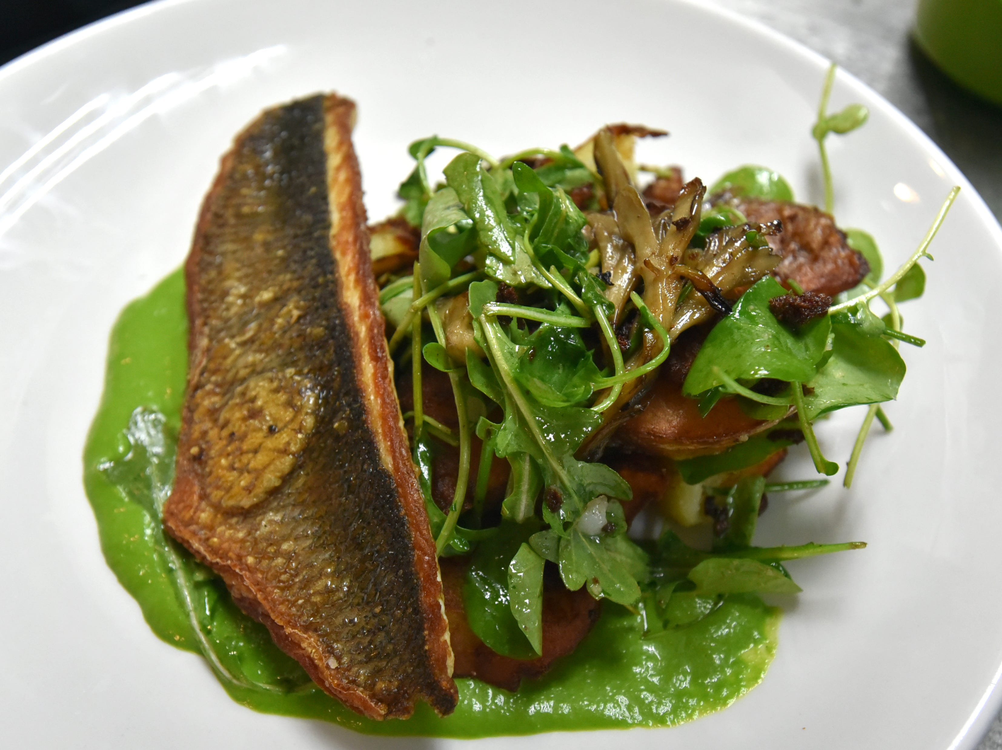 Birmingham's Social Bar and Grill's grilled branzino with miatake mushrooms, sauteed potatoes and arugula puree.