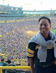 After Li Hu noticed how Oshkosh became a ghost town during Sundays in the football season, he started to learn more and became a Packers fan.
