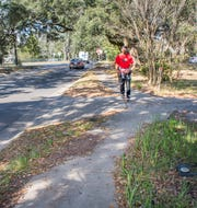 Marcus Knight follows the winding sidewalk as he makes his way along 3700 blocks of North 12th Avenue in Pensacola on Monday, January 28, 2019.  This sidewalk scored a 30 on the city of Pensacola's audit of ADA compliance.