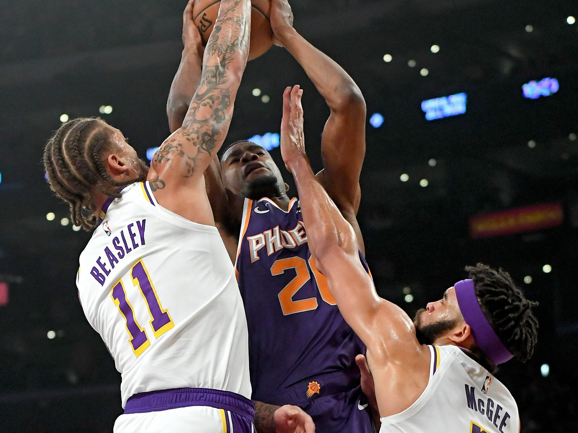 Jan 27, 2019: Los Angeles Lakers center JaVale McGee (7) and forward Michael Beasley (11) reach to block a shot by Phoenix Suns forward Josh Jackson (20) in the first half of the game at Staples Center.