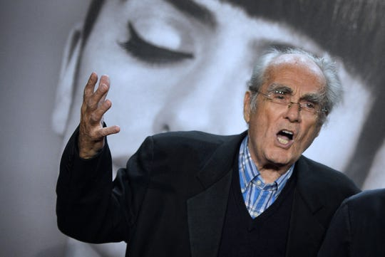French composer and singer Michel Legrand takes part on October 13, 2014 in the opening ceremony of the Fifth Lumiere Film Festival in Lyon. A