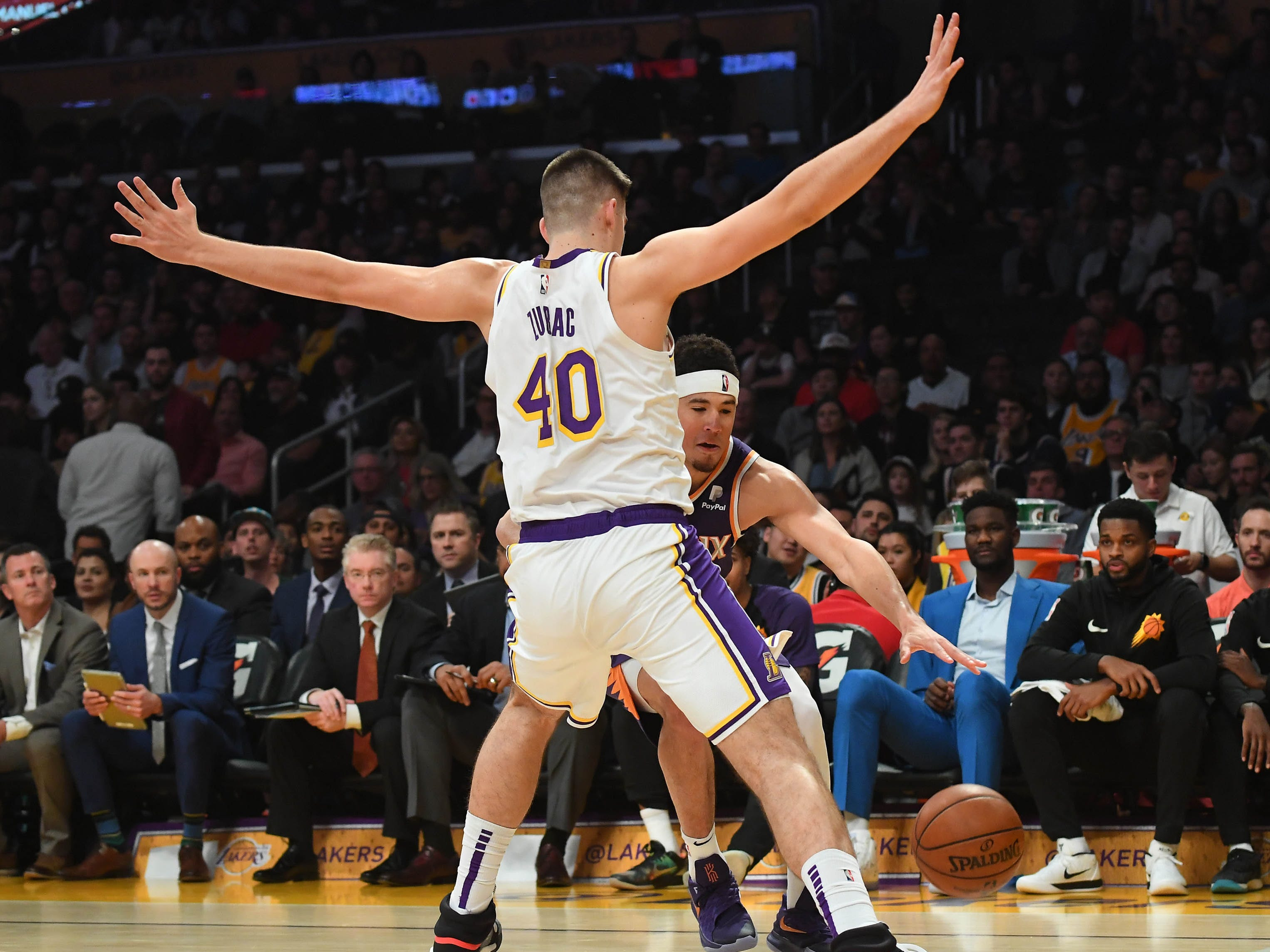 Jan 27, 2019; Los Angeles, CA, USA; Los Angeles Lakers center Ivica Zubac (40) guards Phoenix Suns guard Devin Booker (1) as drives to the basket in the first half of the game at Staples Center. Mandatory Credit: Jayne Kamin-Oncea-USA TODAY Sports