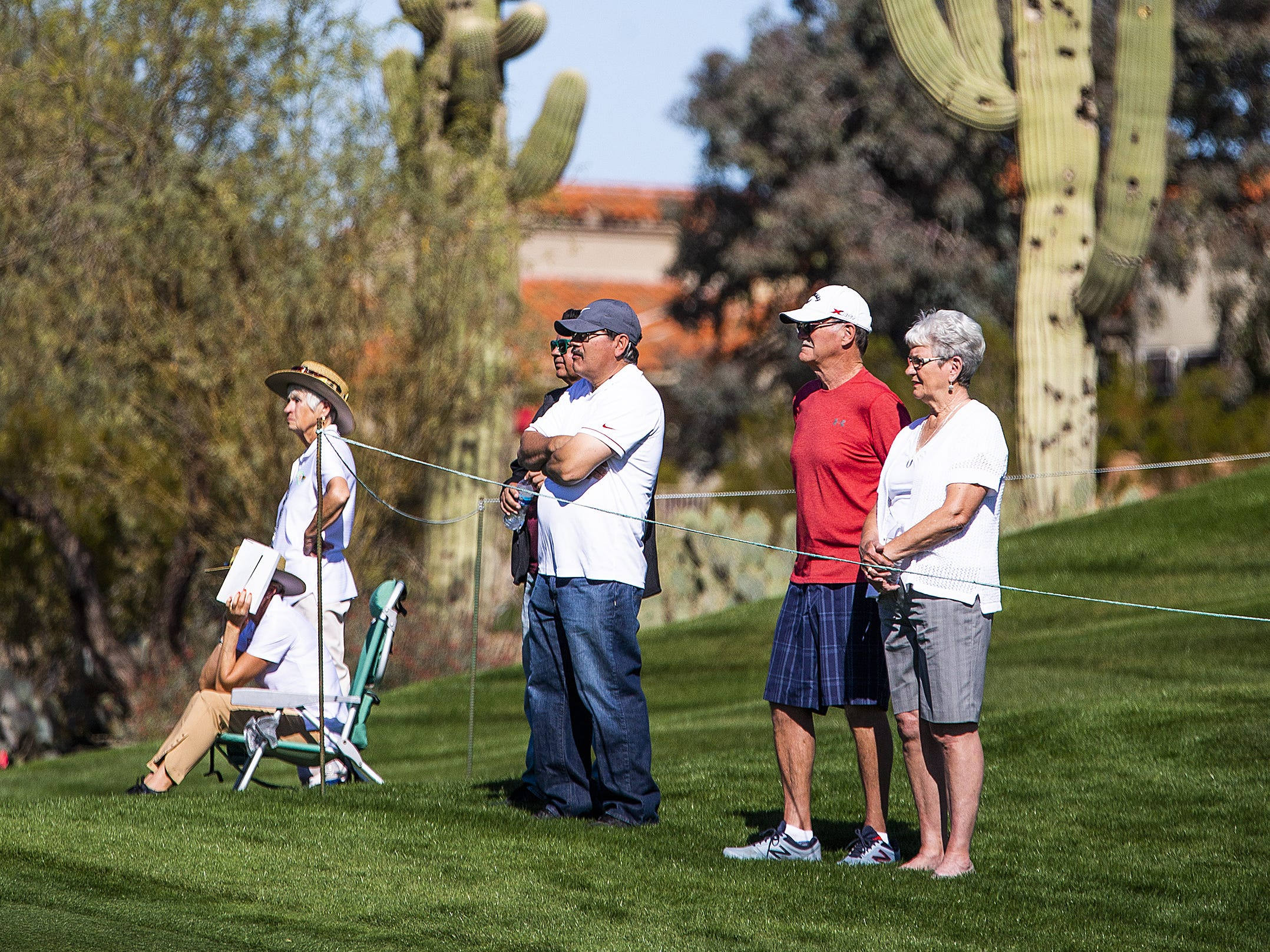 Fans watch golf action on the 2nd hole during the Kadima.Ventures Pro-Am at the Waste Management Phoenix Open at the TPC Scottsdale, Monday, January 28, 2019.