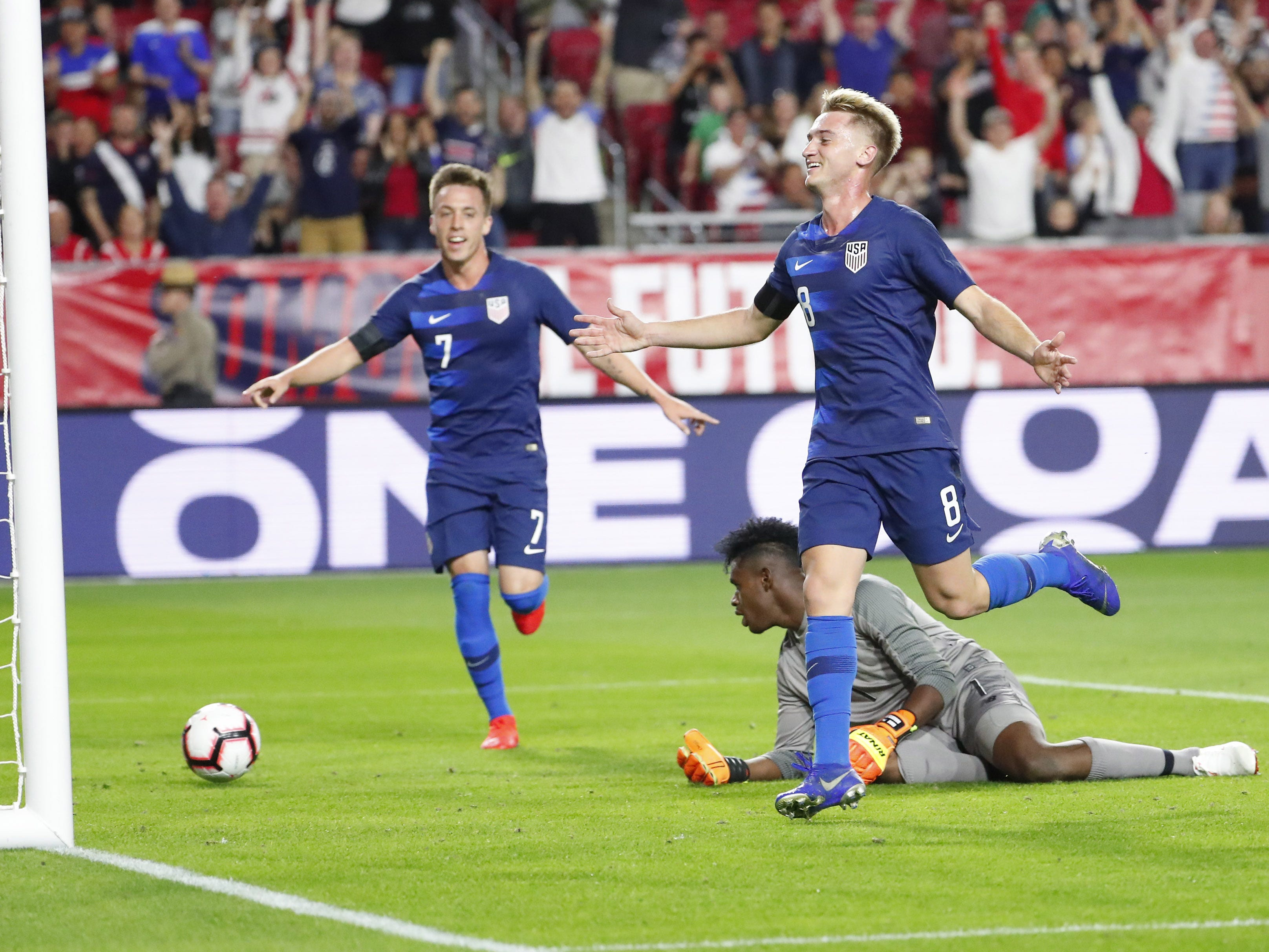 U.S. midfielder Djordje Mihailovic (8) celebrates after scoring against Panama goalkeeper Eddie Roberts (1) during the first half of a friendly between Jan. 27, 2019 in Glendale, Ariz. Forward Corey Baird (7) is at left.