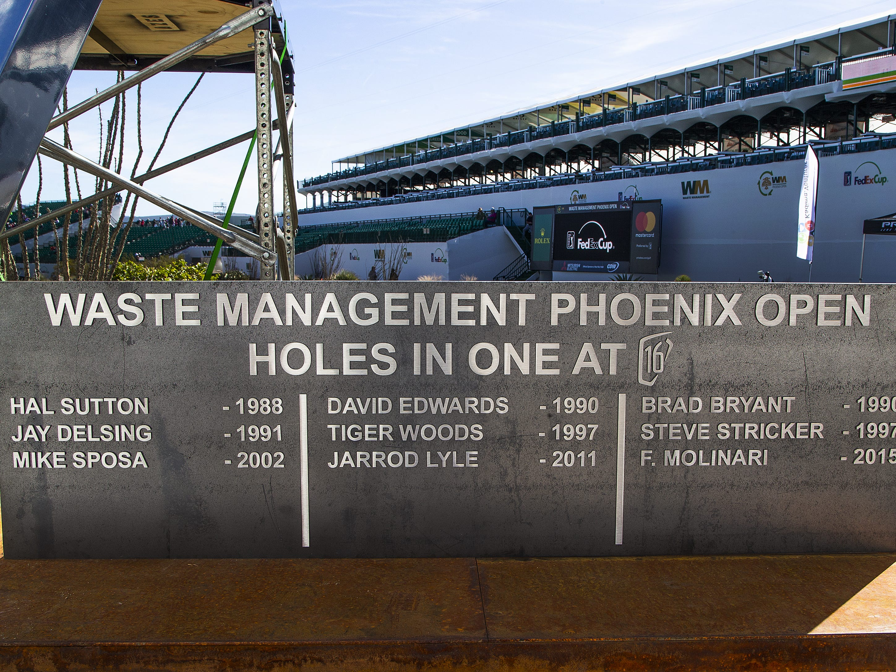 A plaque lists all the golfers who have hit a hole in one on the 16th hole at the Waste Management Phoenix Open at the TPC Scottsdale, Monday, January 28, 2019.