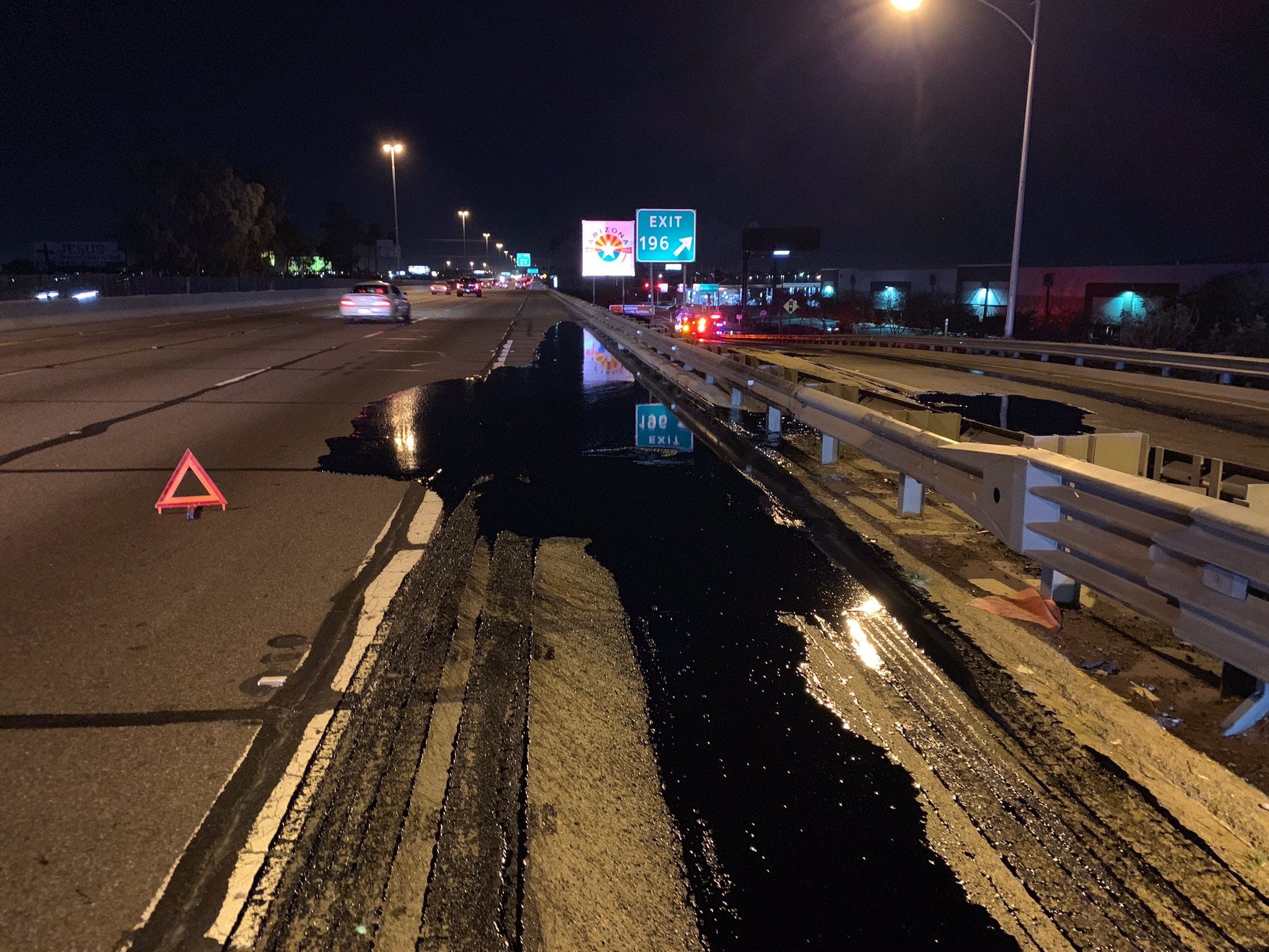 Tar spills onto southbound Interstate 17 at Seventh Avenue in Phoenix on Jan. 28, 2019.