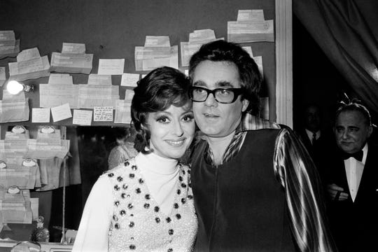 Michel Legrand and Italian singer Caterina Valente pose at the Olympia concert hall, on Jan. 20, 1972, in Paris.