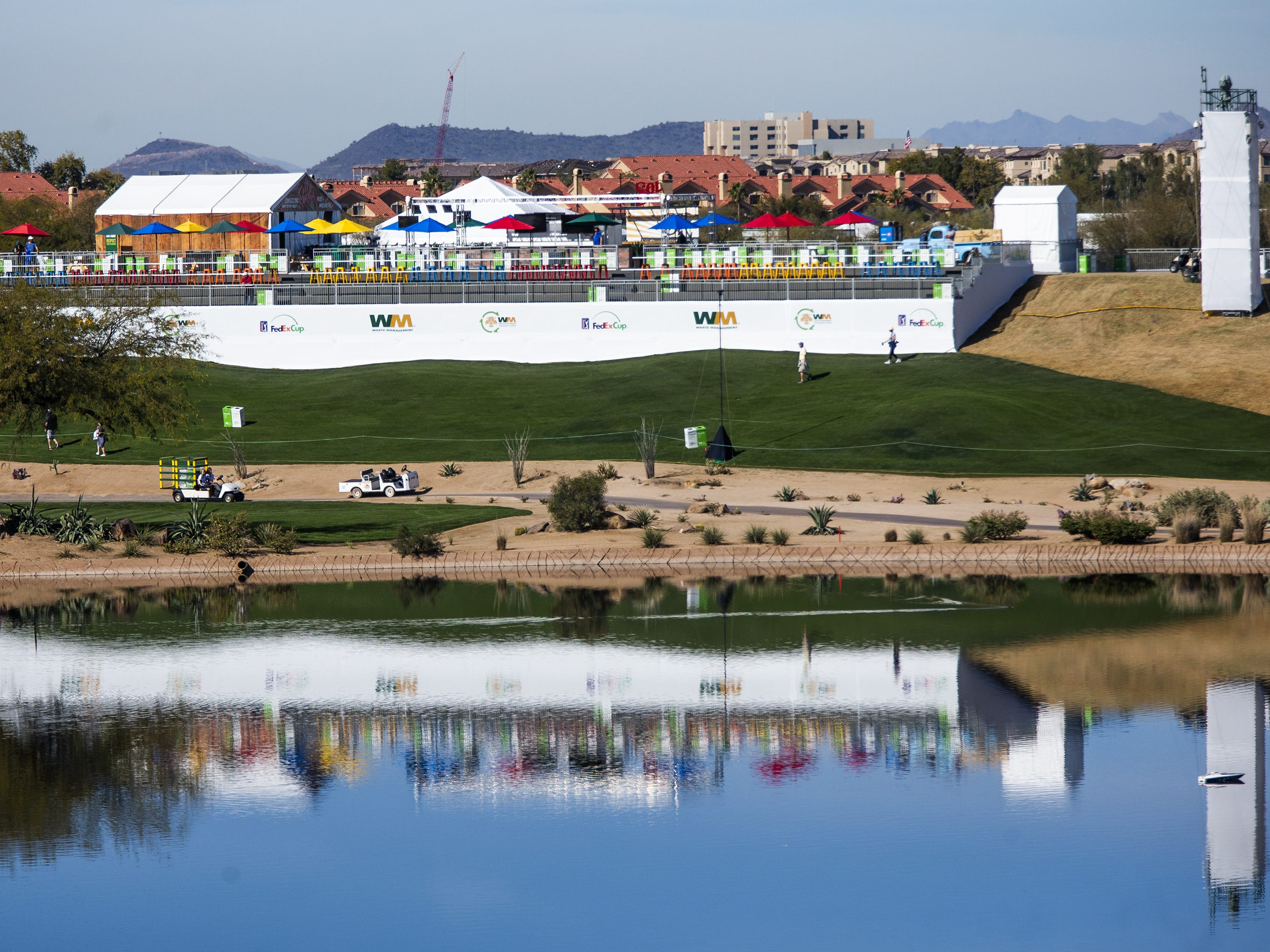 Grandstands near the 12th hole are reflected in a pond during the Kadima.Ventures Pro-Am at the Waste Management Phoenix Open at the TPC Scottsdale, Monday, January 28, 2019.