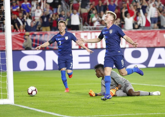 U.S. midfielder Djordje Mihailovic (8) and forward Corey Baird celebrate the first goal of the Gregg Berhalter debut on Sunday at State Farm Stadium.