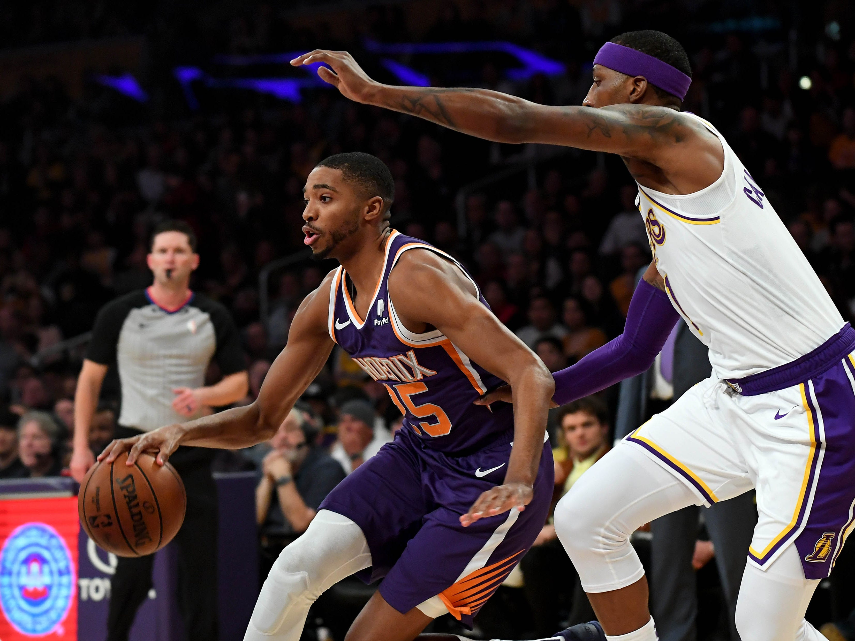 Jan 27, 2019; Los Angeles, CA, USA; Los Angeles Lakers guard Kentavious Caldwell-Pope (1) guards Phoenix Suns forward Mikal Bridges (25) as drives to the basket in the first half of the game at Staples Center. Mandatory Credit: Jayne Kamin-Oncea-USA TODAY Sports