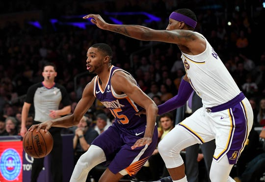 Mikal Bridges drives to the basket against Lakers guard Kentavious Caldwell-Pope during a game Jan. 27 at Staples Center.