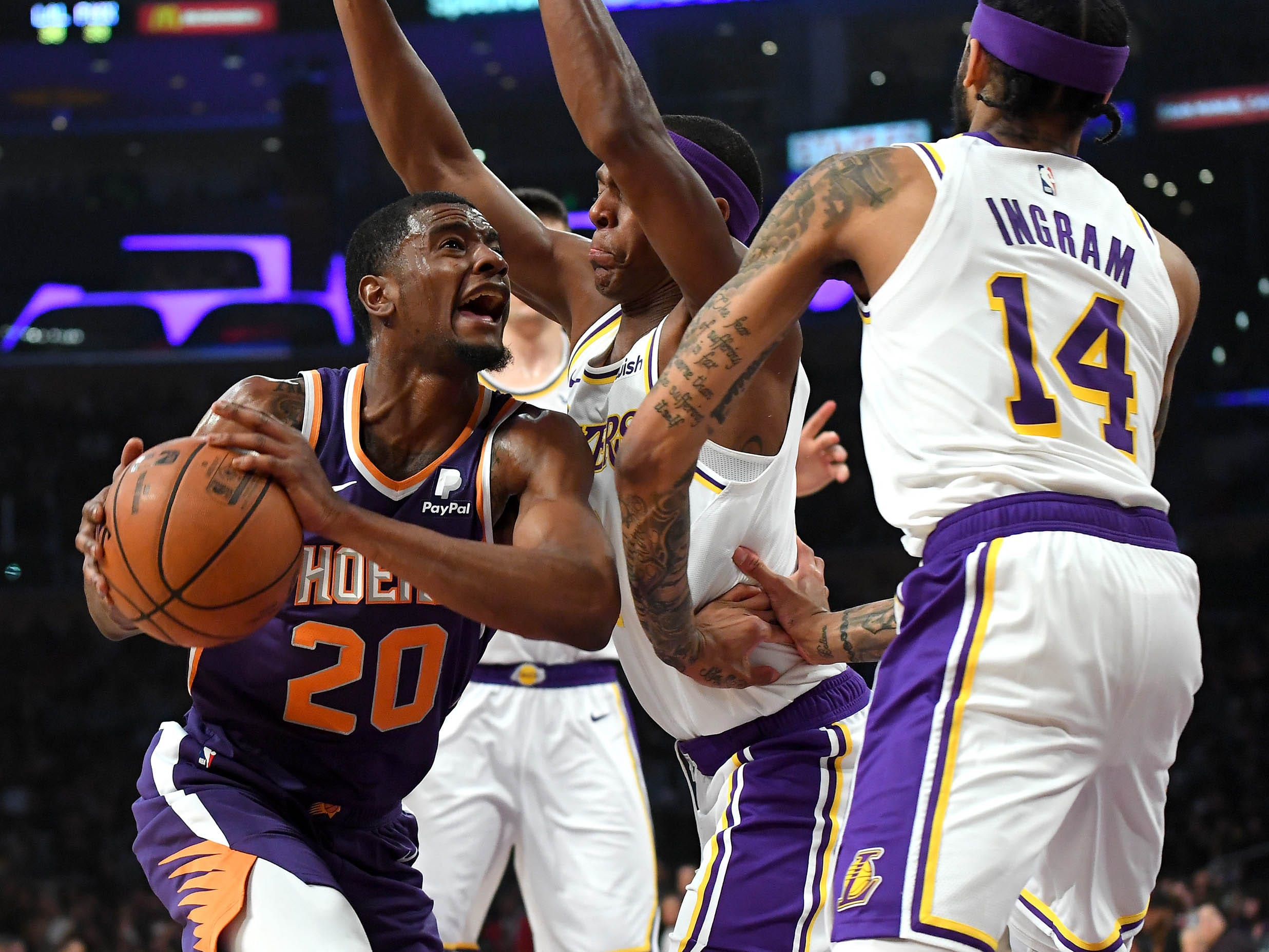 Jan 27, 2019: Los Angeles Lakers guard Kentavious Caldwell-Pope (1) and forward Brandon Ingram (14) guard Phoenix Suns forward Josh Jackson (20) as he drives to the basket in the first half of the game at Staples Center.