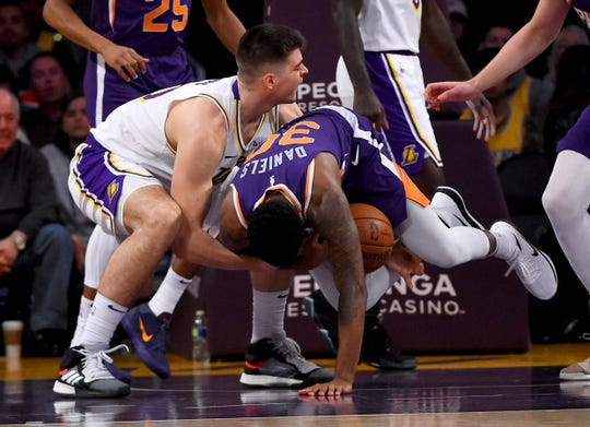 Jan 27, 2019: Los Angeles Lakers center Ivica Zubac (40) and Phoenix Suns guard Troy Daniels (30) wrestle for a loose ball in the first half of the game at Staples Center.
