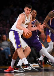 Suns forward Emanuel Terry defends Lakers center Ivica Zubac during the first quarter of a game at Staples Center.