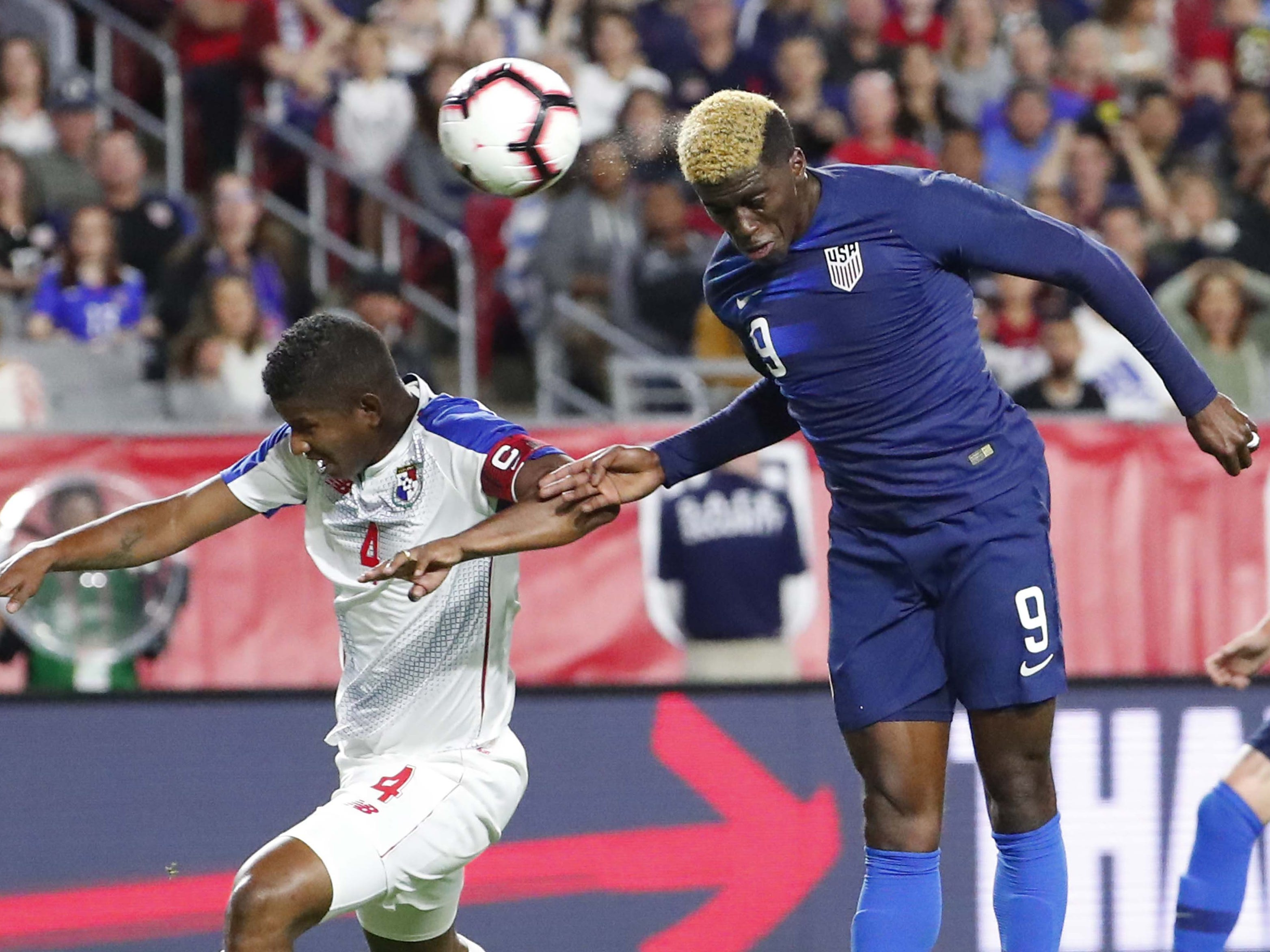U.S. Gyasi Zardes (9) takes a shot while defended by Panama defender Fidel Escobar (4) during the first half of a friendly between Jan. 27, 2019 in Glendale, Ariz.