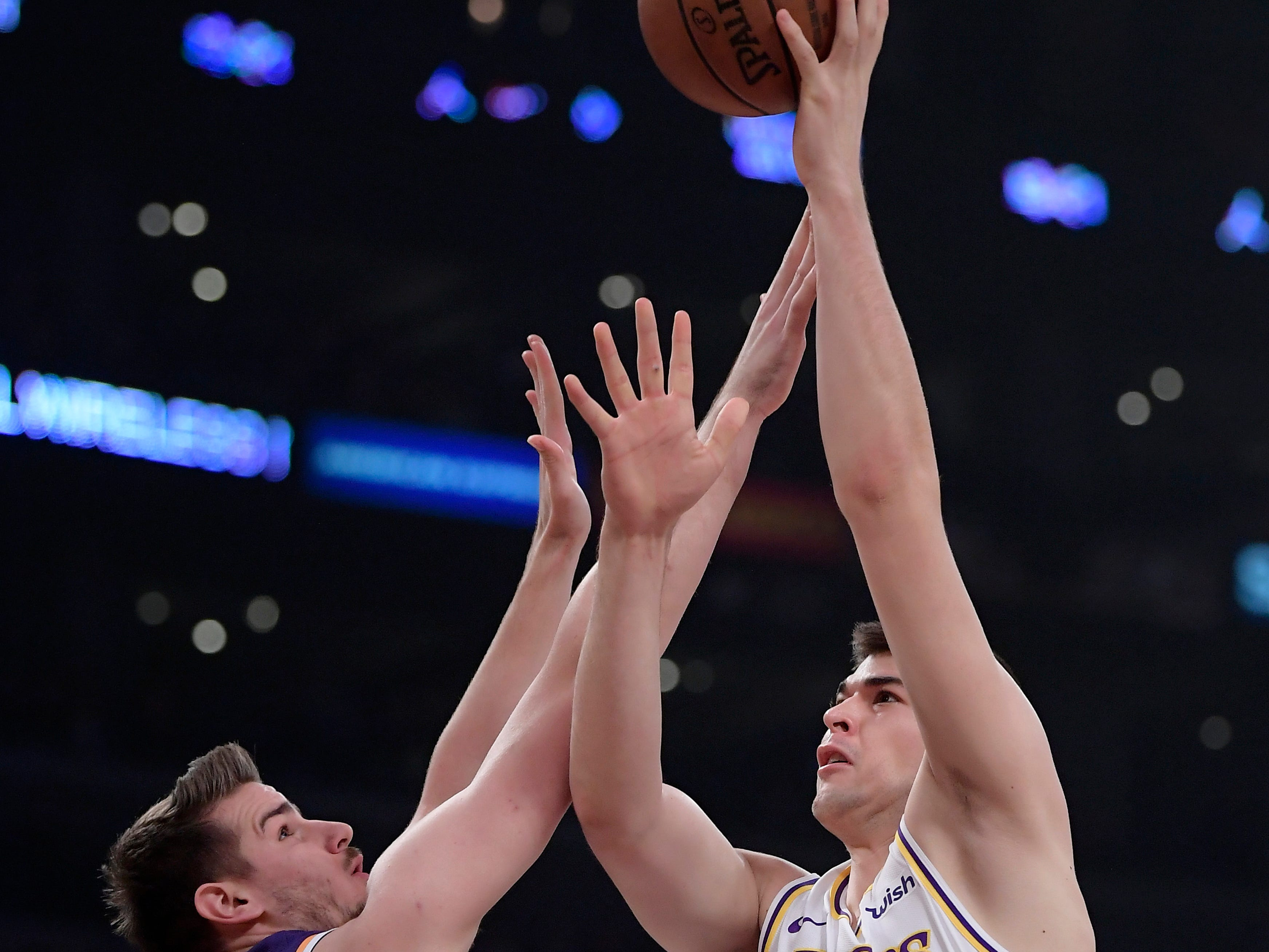 Los Angeles Lakers center Ivica Zubac, right, shoots as Phoenix Suns forward Dragan Bender defends during the first half on Sunday, Jan. 27, 2019, in Los Angeles. (AP Photo/Mark J. Terrill)