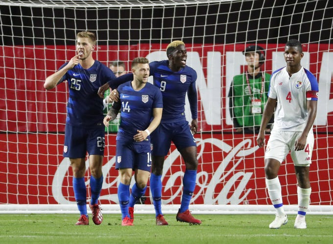 U.S. defender Walker Zimmerman (25) celebrates with midfielder Paul Arriola (14) and forward Gyasi Zardes (9) after scoring against Panama during the second half of a friendly on Jan. 27, 2019 in Glendale, Ariz. The U.S. won 3-0.
