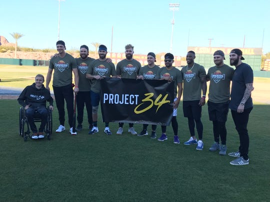 Bobby Dalbec, second from left, won the first Dingers in the Desert home run derby. The event was a fundraiser for Project 34, founded by former ASU players Cory Hahn, left, and Trevor Williams, right.