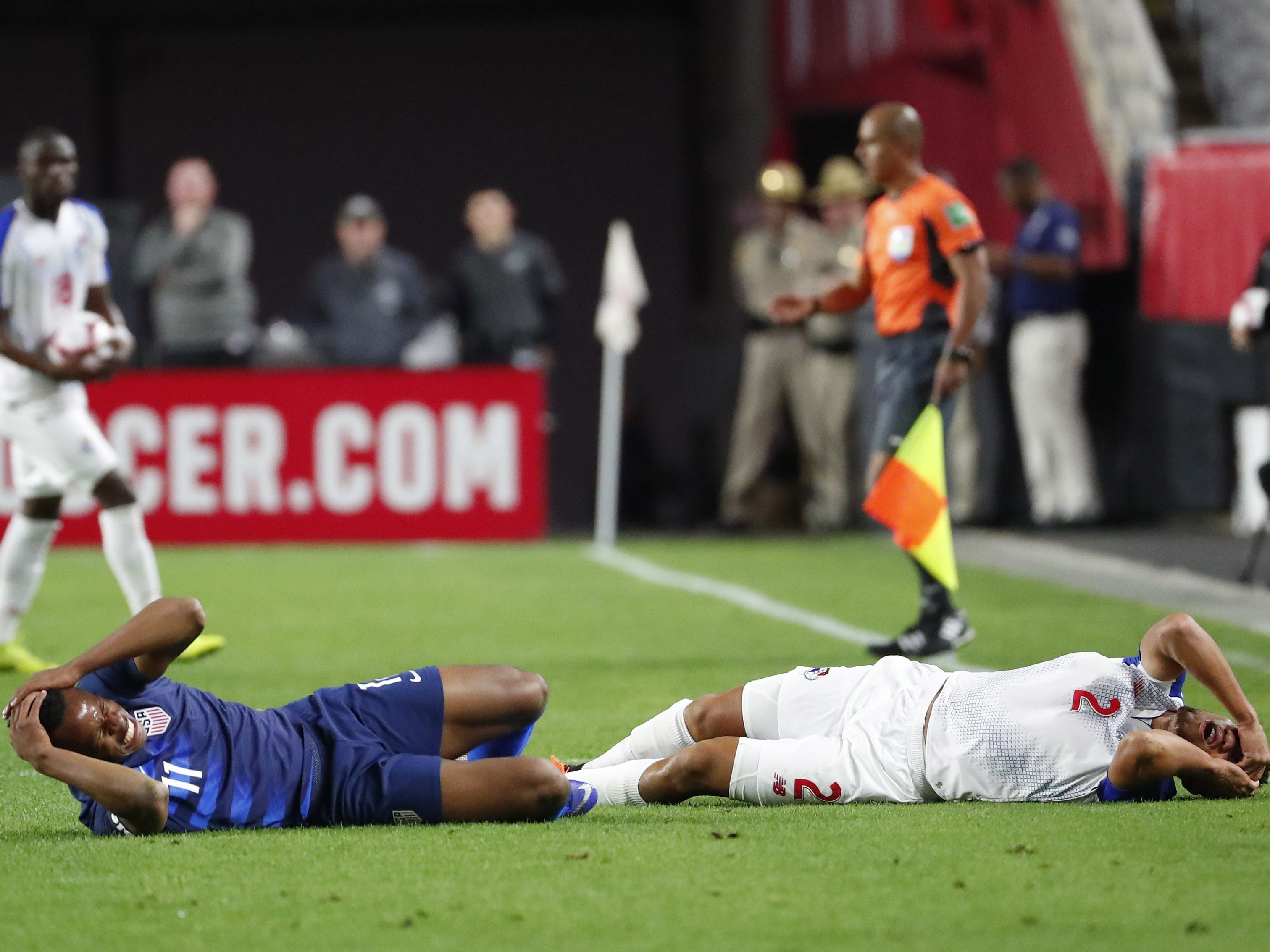 U.S. forward Jeremy Ebobisse (11) and Panama defender Francisco Palacios (2) lay on the ground after colliding on a header during the first half of a friendly on Jan. 27, 2019 in Glendale, Ariz.
