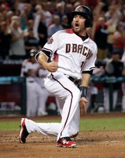 Arizona Diamondbacks A.J. Pollock scores on a hit by teammate Jake Lamb against the Colorado Rockies during the first inning of a baseball game Thursday, March 29, 2018, in Phoenix. (AP Photo/Matt York)