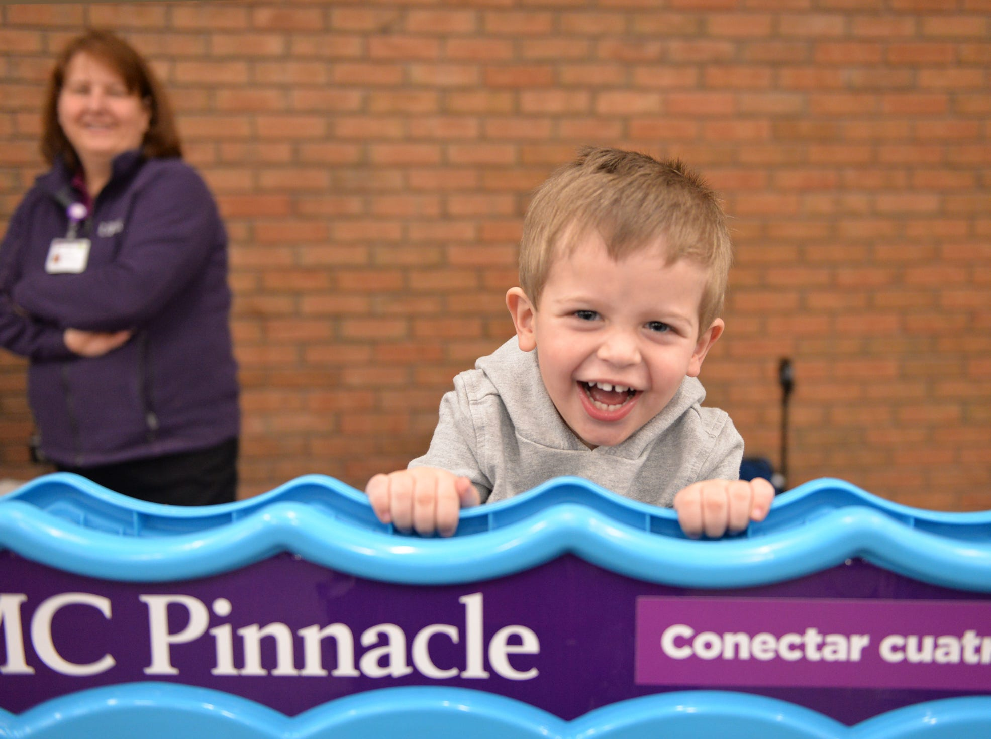 Two-year old Braxtin Rhen of Lebanon enjoys one of the kids games at The Lebanon Rotary Club's Bologna Fest & Winter Carnival held on Saturday, January 26 at the Lebanon Valley Expo Center.