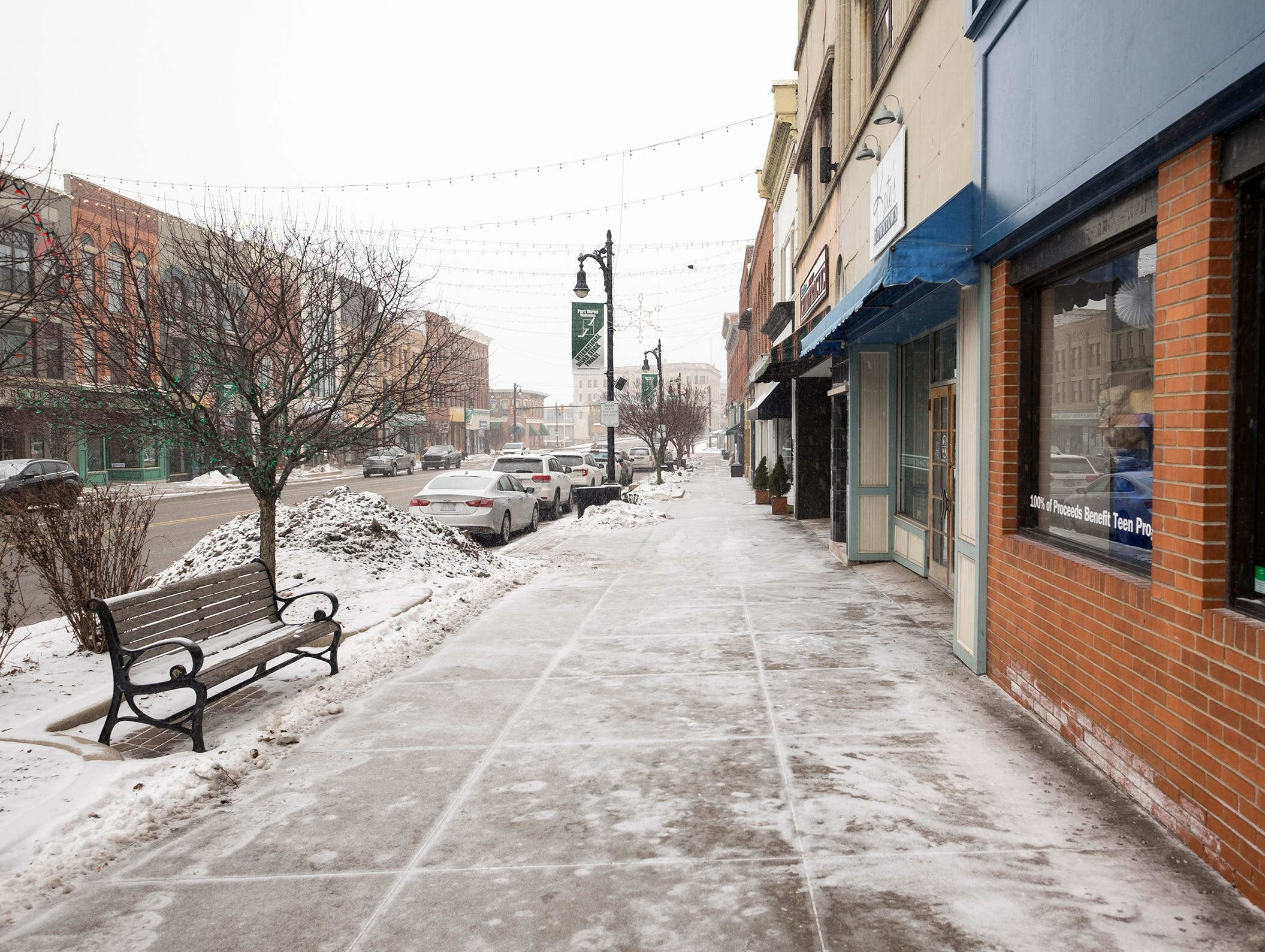 Snow falls in downtown Port Huron Monday, Jan. 28, 2019. As of noon Monday, the National Weather Service predicted a total snow accumulation of 7 to 9 inches over the northern side of St. Clair County, with 4 to 6 inches predicted for south of I-69.