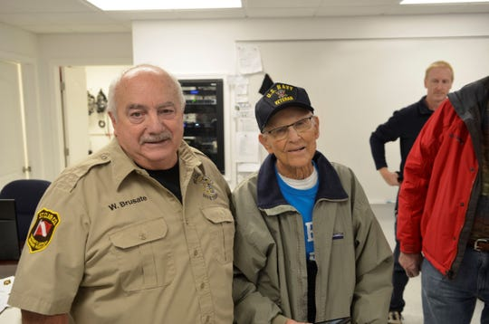 Wayne Brusate and Don Evans stand together at an open house for the St. Clair County Dive Team on Nov. 18, 2018, in Marysville.