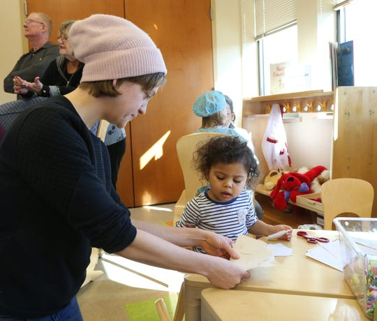 Chelsea Acree helps her daughter Logan during preschooler learning center story time and guided play at Adriance Memorial Library in the City of Poughkeepsie on January 28, 2019.