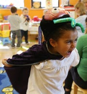 Victoria Mitchell of Poughkeepsie wears a costume and during preschooler learning center story time and guided play at Adriance Memorial Library in the City of Poughkeepsie on January 28, 2019.
