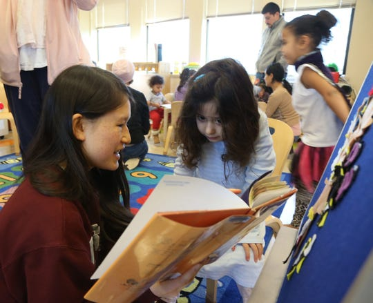 Tamika Witenack, a Vassar College sophomore from California reads to Amelie Goldschmidt of Poughkeepsie during preschooler learning center story time and guided play at Adriance Memorial Library in the City of Poughkeepsie on January 28, 2019.
