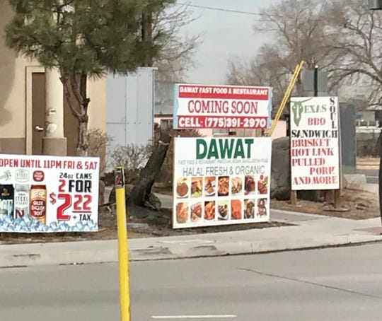 On East Moana Lane, a sign announces the upcoming Dawat serving halal food allowed under Islamic law.