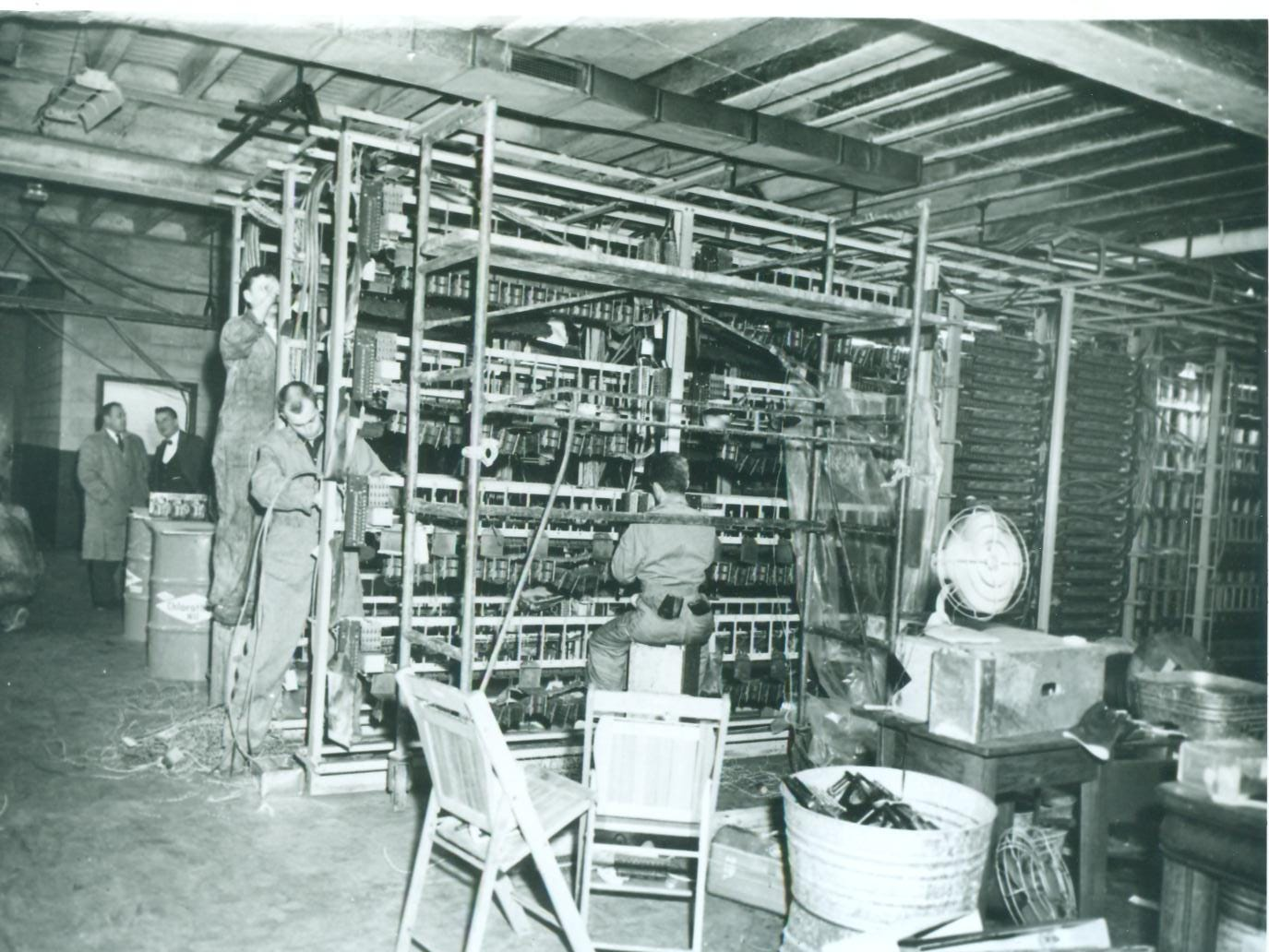 General Telephone crews began the arduous task of splicing ruined cables and trunk connections together in February 1965 after the worst communications blackout in Indiana history.