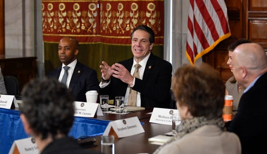 New York Gov. Andrew Cuomo meets with survivors and Child Victims Act advocates in the Red Room during a news conference at the state Capitol on Monday, Jan. 28, 2019, in Albany, N.Y.