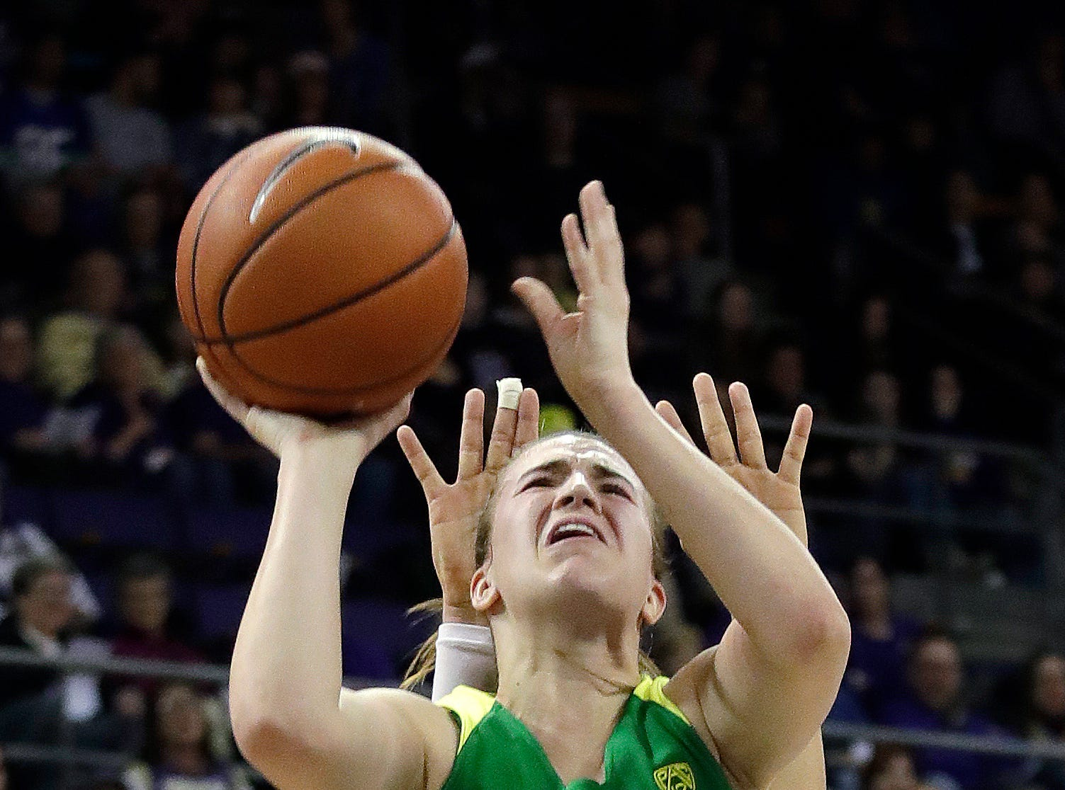 Oregon's Sabrina Ionescu is fouled by a Washington player in the first half of an NCAA college basketball game Sunday, Jan. 27, 2019, in Seattle.