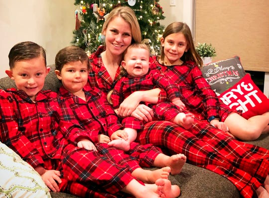 In this December 2018 photo, Jocelyn Smith poses with her four children, from left, Tucker, 6, George, 3, Mason, 11 months old, and Lucy, 9, in Camas, Wash. Smith says she hasn't gone out in public with Mason for 10 days because he's still too little to be vaccinated against the measles and she's afraid he will be exposed to the virus.