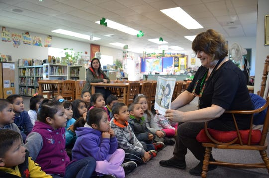 Bardin Elementary Librarian Patti Crawford reads to a first grade class group in April 2018.