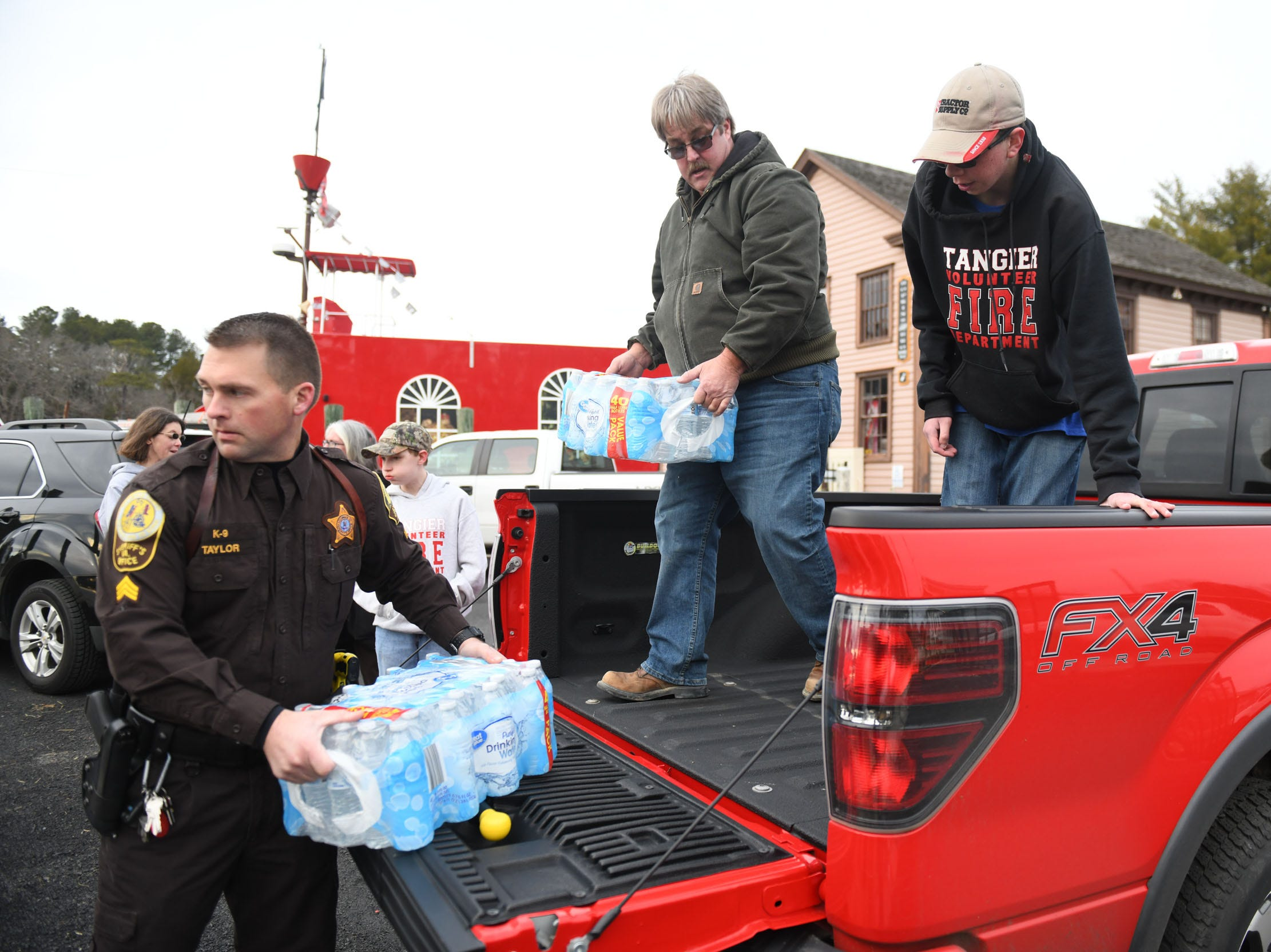 Members of the community gathered at the Onancock Wharf help load donated water and hay to take to Tangier Island on the Joyce Marie II on Monday,  Jan. 28, 2019.