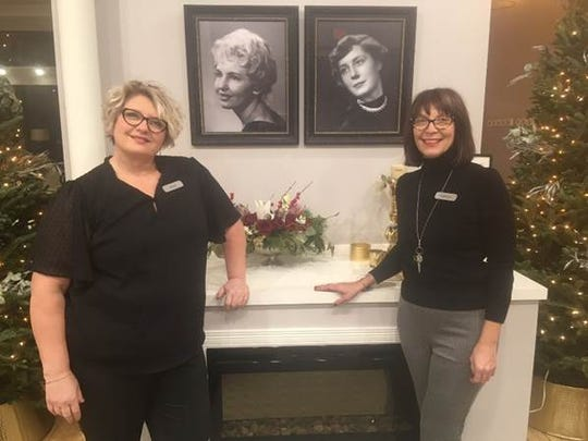 K Lorraine co-owners Vicky LeMahieu (left) and Kathryn Hillstrom (right) standing by photos of their mothers, who inspired the name of the new salon.