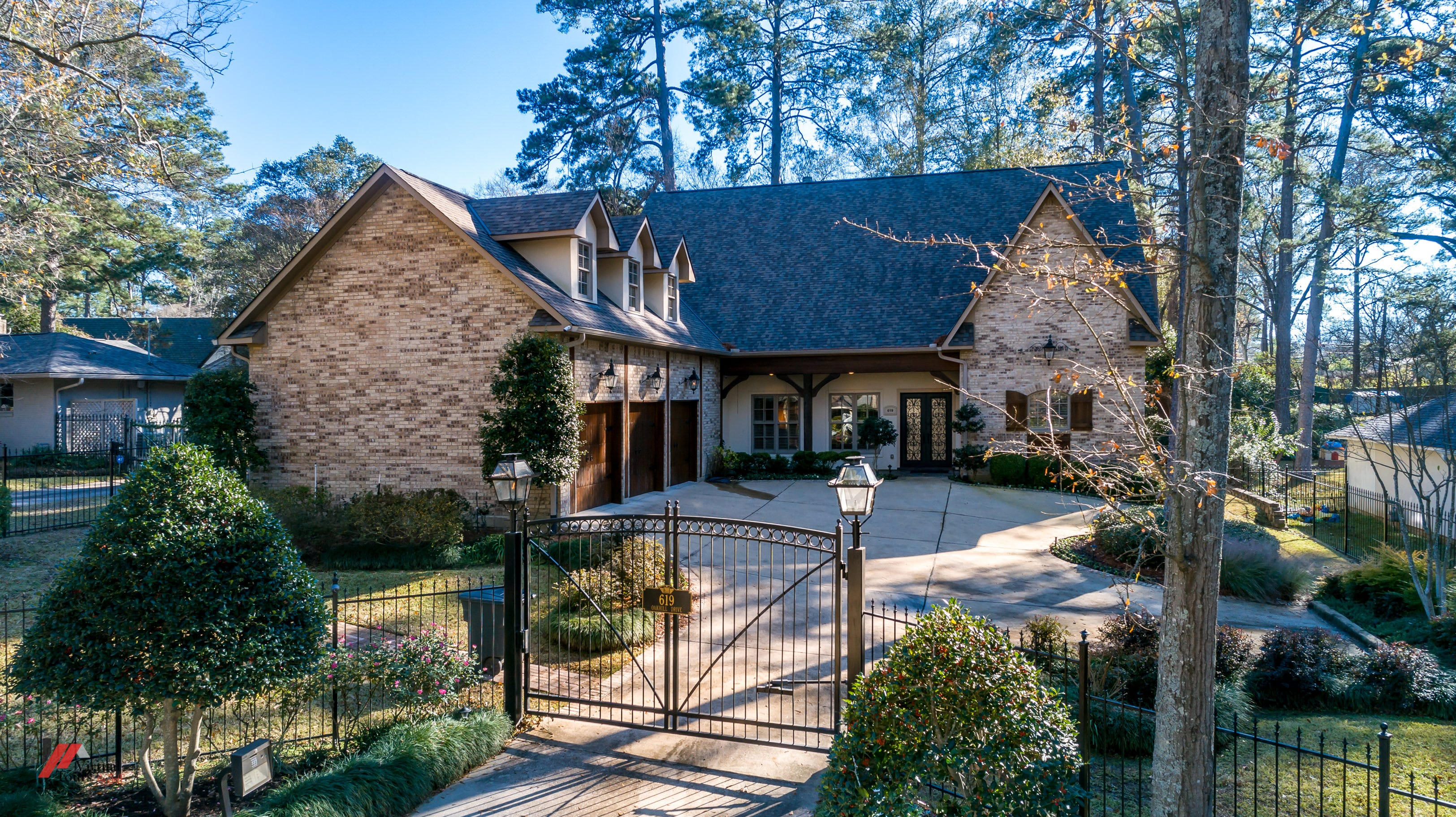 Professional landscaping and copper gas lanterns add to the charm of 619 Oak Hill Drive.