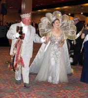 Krewe Artemis King XVII Kevin Dinkins and Queen Kari Dinkins walk the floor after their presentation at Krewe Artemis Grande Bal XVII.