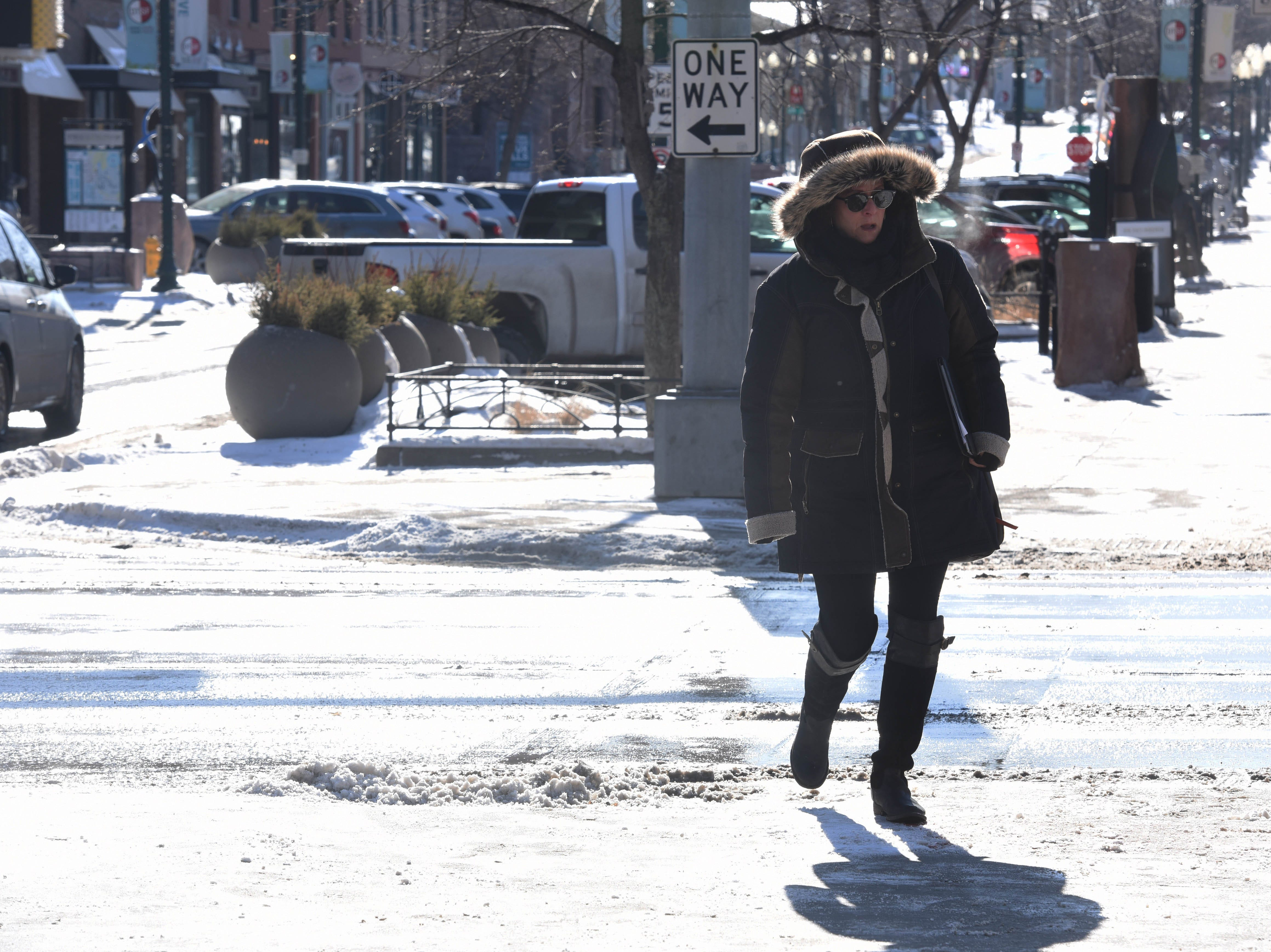 Sara Crosby walks through downtown Sioux Falls, S.D., Monday, Jan. 28, 2019.