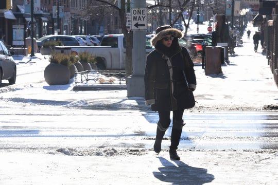 Sara Crosby walks through downtown Sioux Falls, S.D., Monday, Jan. 28, 2019.