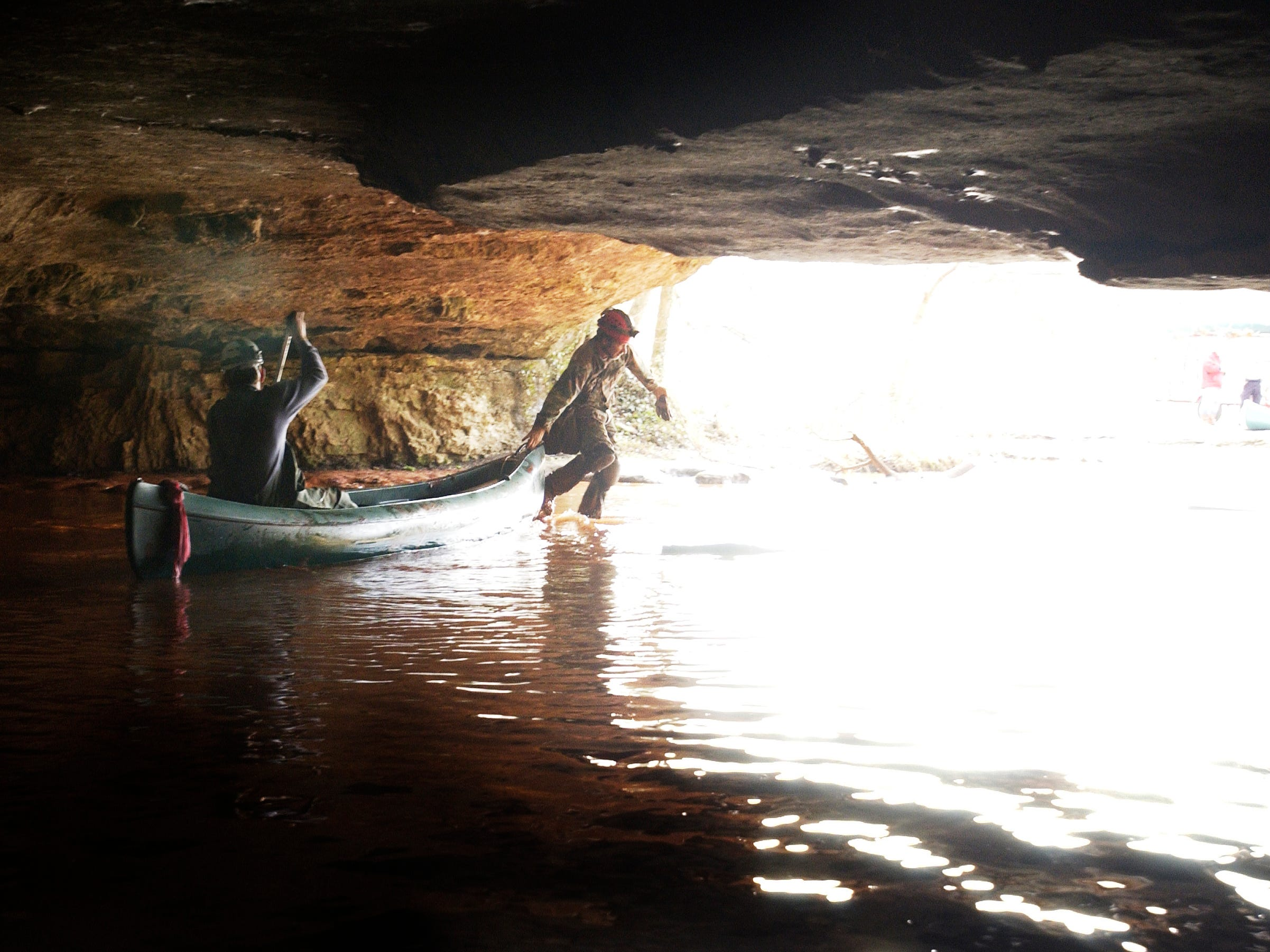 MSU geologist Dave Gaunt, right, pulls his canoe out of the mouth of the Sequiota Park Cave. Jess Heugel/ News-Leader.