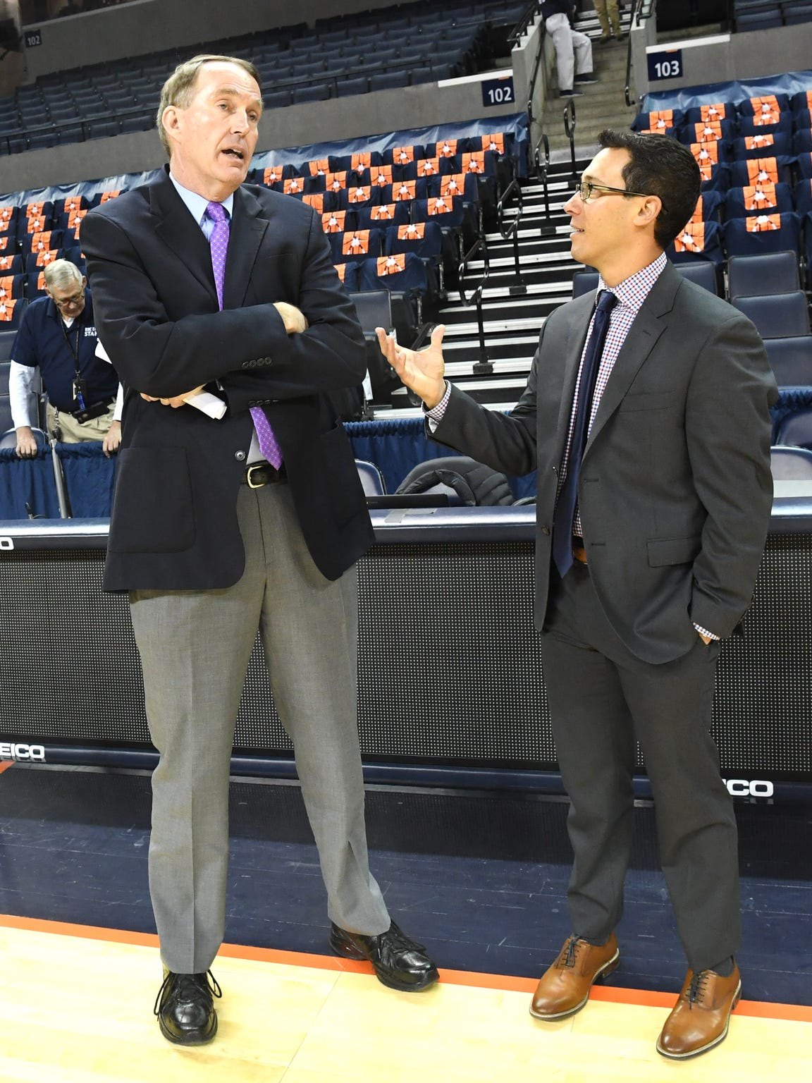 Dan Bonner and Justin Kutcher, the announcers for Raycom's television broadcast of Wake Forest-UVA on Tuesday, Jan. 22, share a pregame chat at John Paul Jones Arena in Charlottesville.